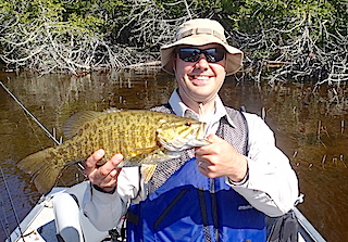 Nick with a Trophy Smallmouth Bass Fishing at Fireside Lodge in Canada